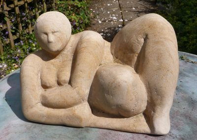 Reclining Figure, carved Ancaster stone