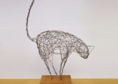Cat, wire, wood base