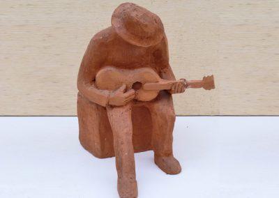 Busker, terracotta (26cm)