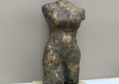 Torso, ciment fondu on Travertine base, 58cm high